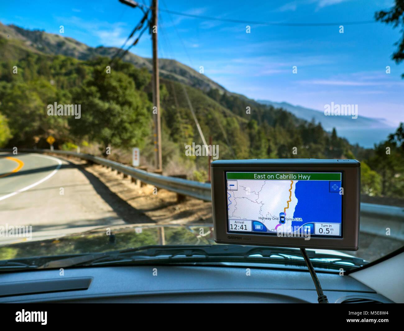 Satellite Navigation screen display of coastal CA Highway One at Cabrillo Highway Pacific Ocean behind Monterey - Stock Image