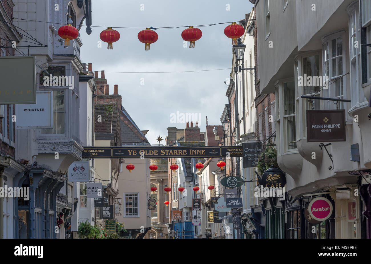The famous Stonegate in York decorated with  lanterns for the Chinese New Year. Stock Photo