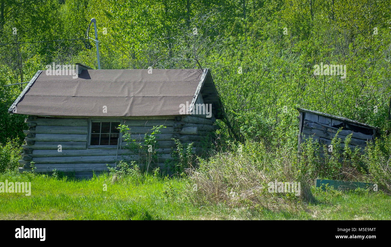 Rustic log cabin in the wilds of Alaska - Stock Image