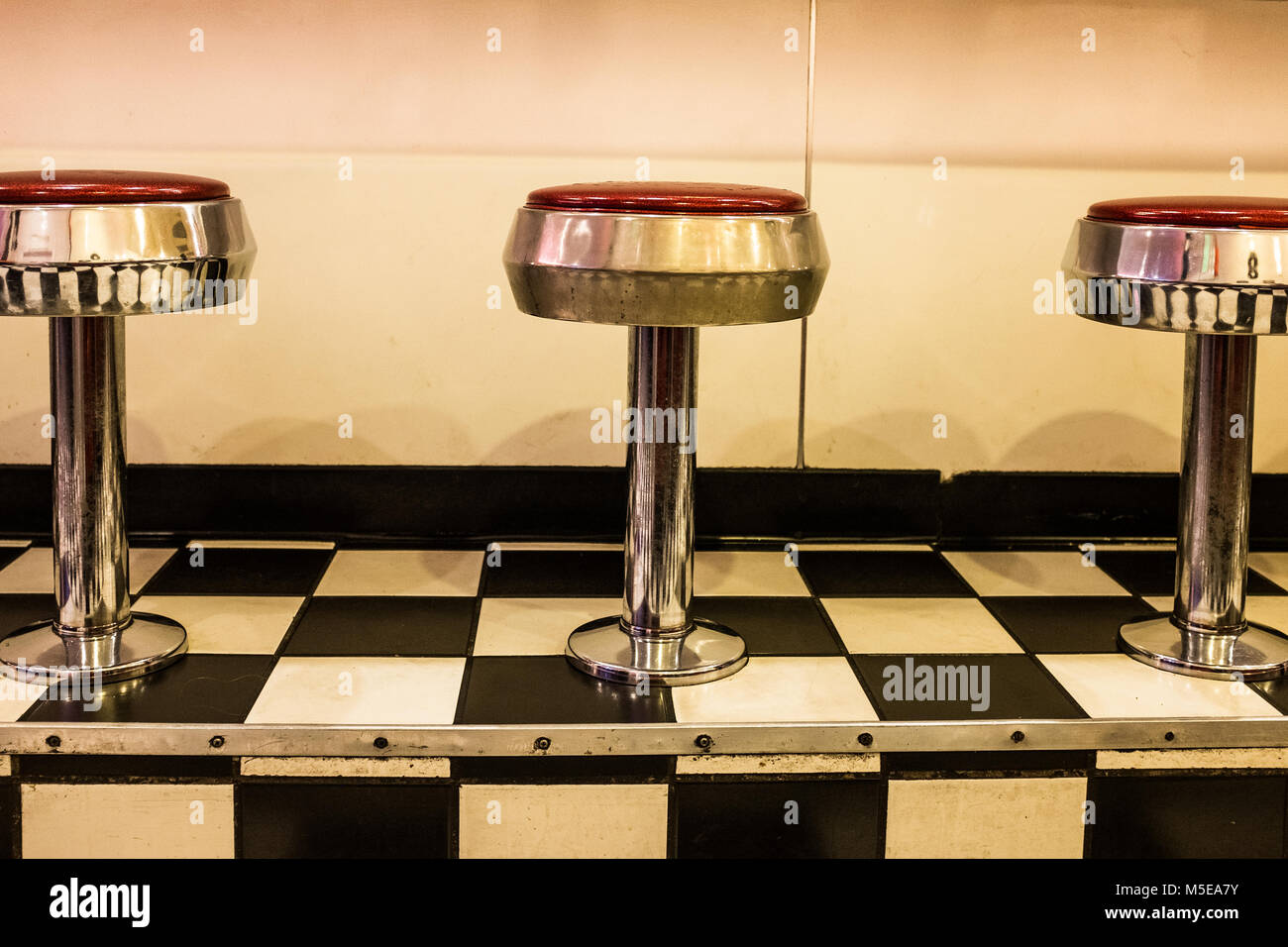 Close Up Of 50s Diner Chrome And Red Stools On Black And White Stock