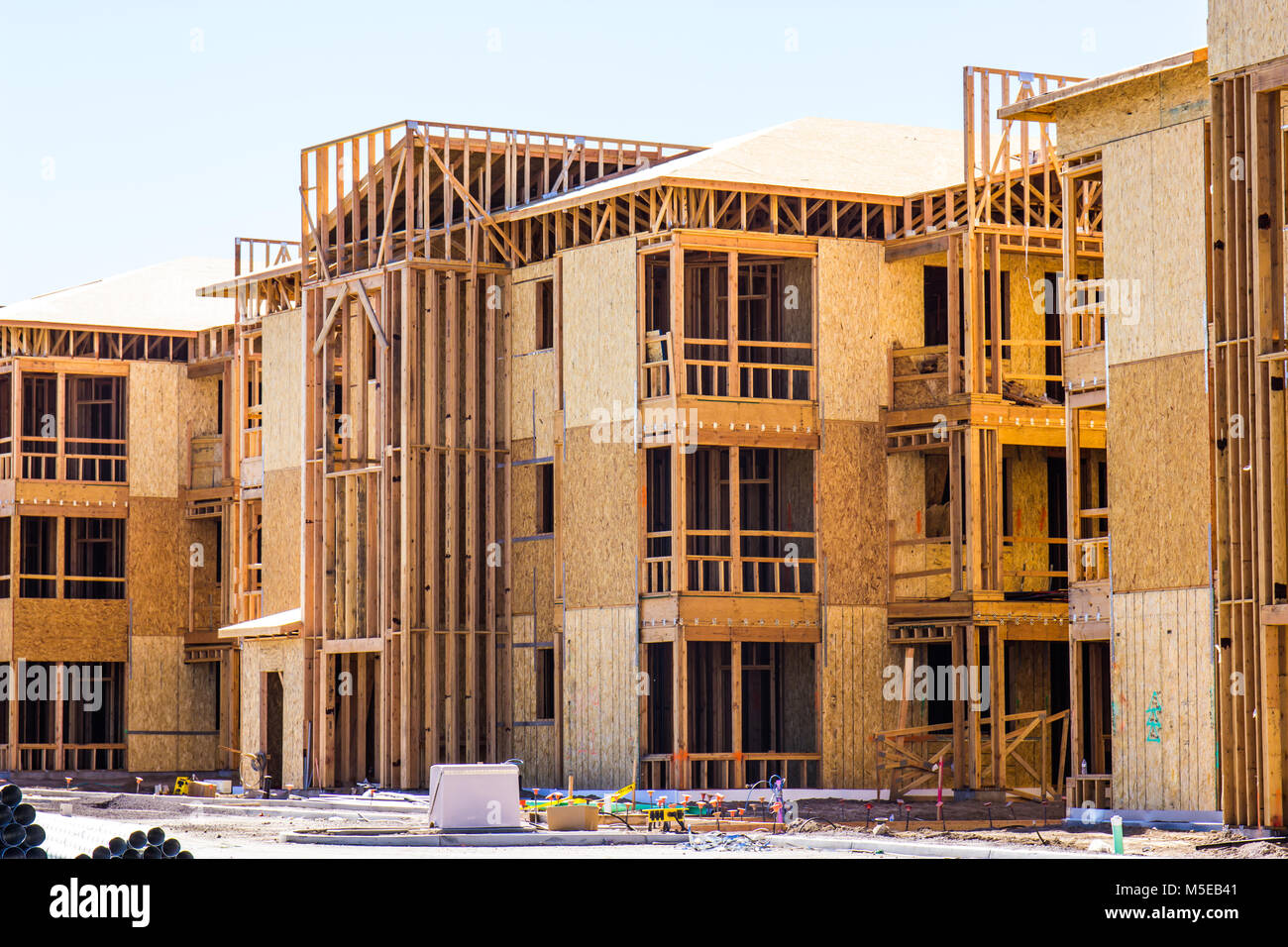 New Three Story Apartment Building Under Construction - Stock Image