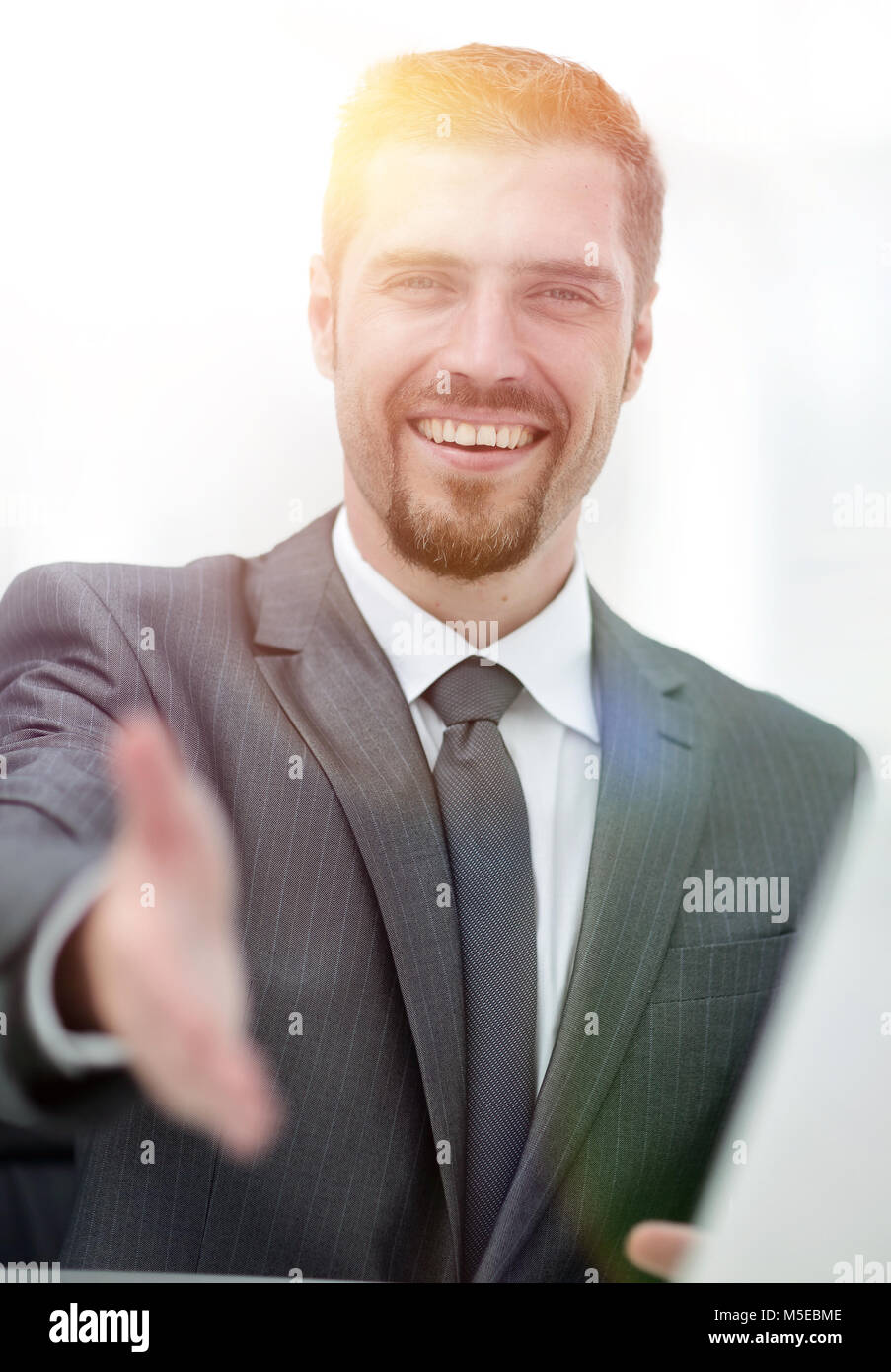 closeup .a successful businessman extends his hand for a handsha - Stock Image