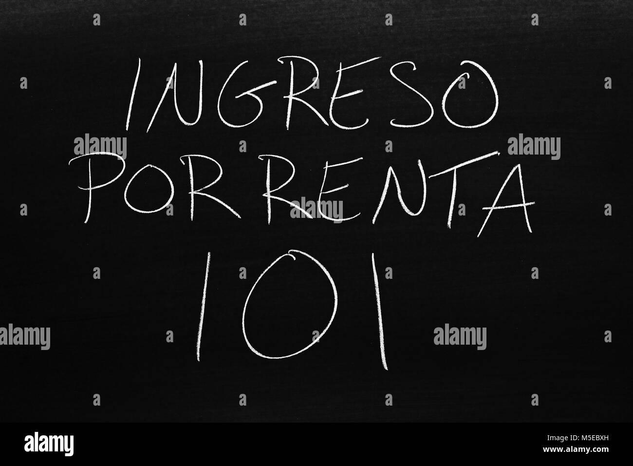 The words Ingreso Por Renta 101 on a blackboard in chalk - Stock Image