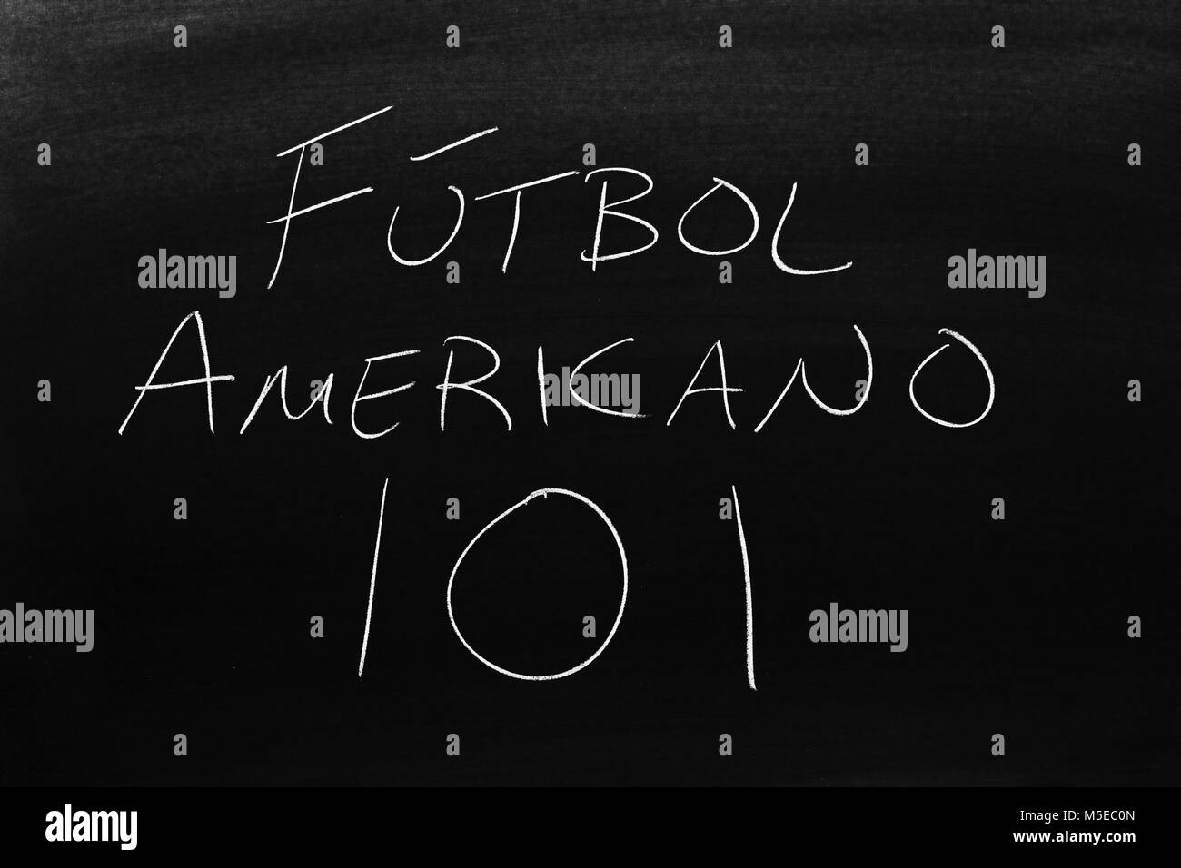 The words Fútbol Americano 101 on a blackboard in chalk - Stock Image