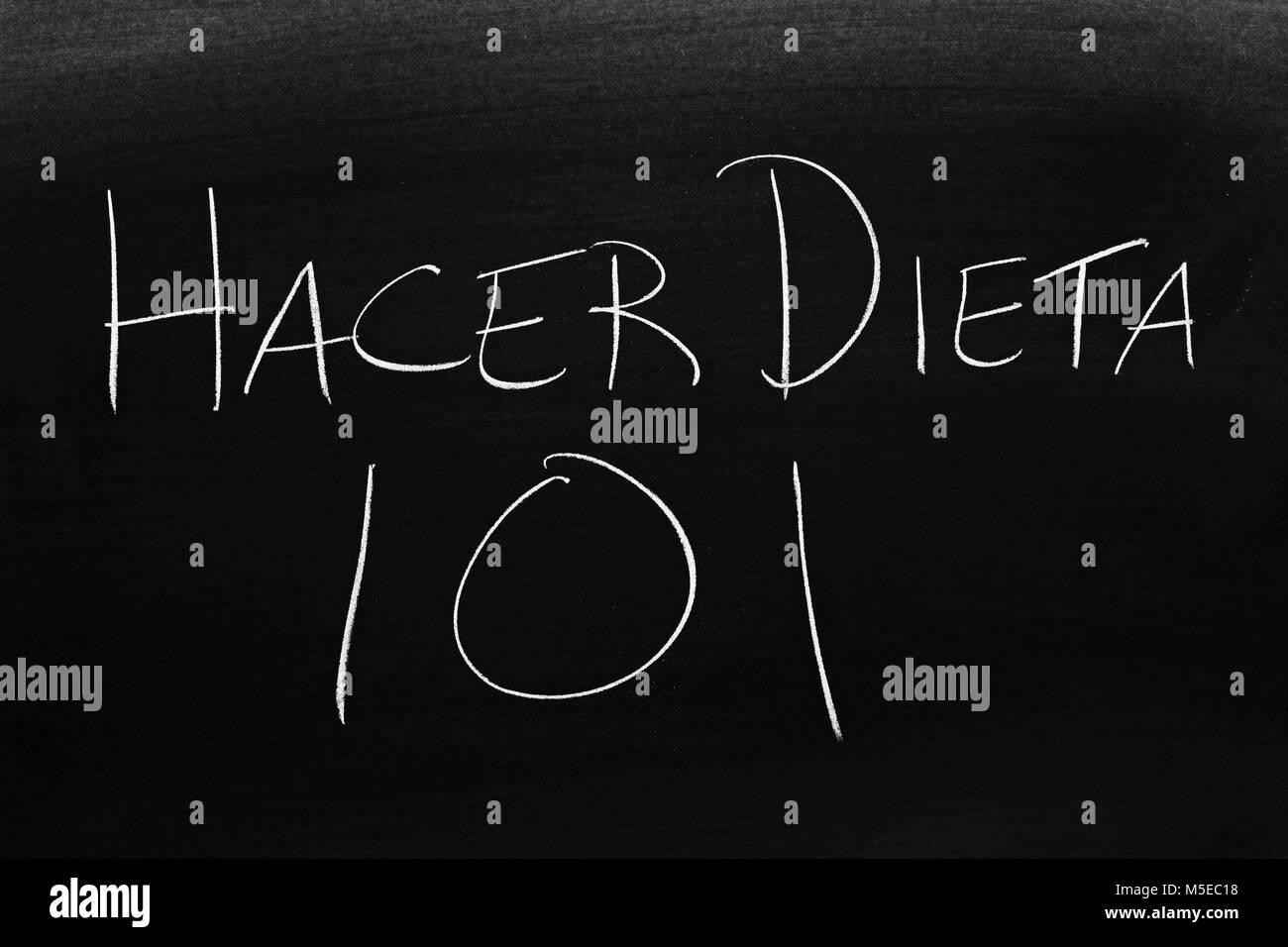 The words Hacer Dieta 101 on a blackboard in chalk - Stock Image