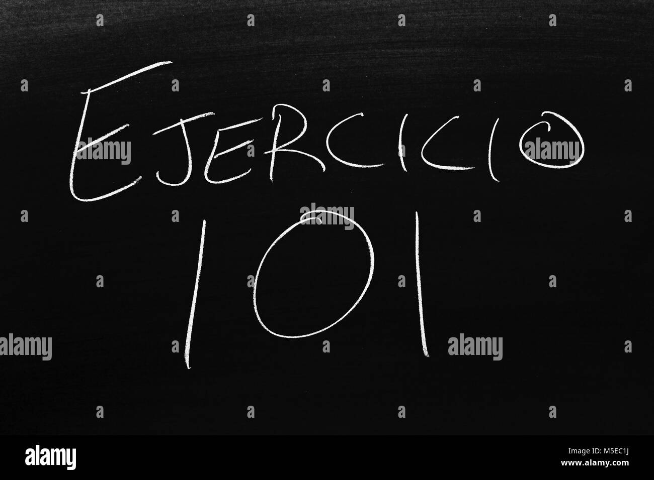 The words Ejercicio 101 on a blackboard in chalk - Stock Image