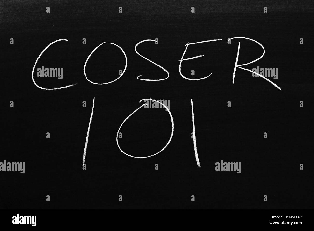 The words Coser 101 on a blackboard in chalk - Stock Image
