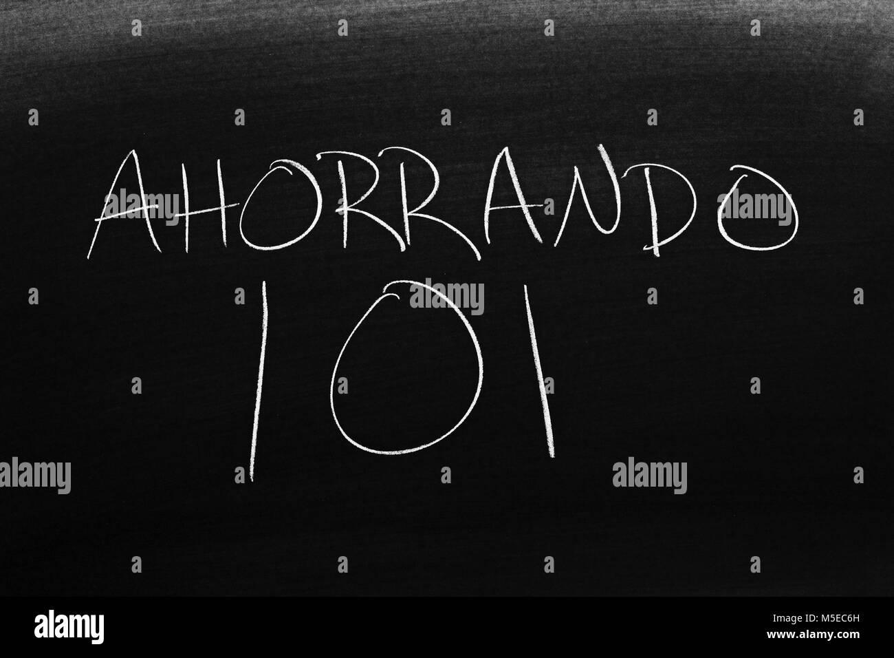 The words Ahorrando 101 on a blackboard in chalk - Stock Image