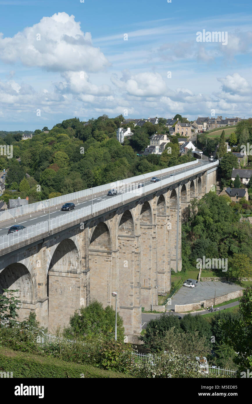 The Viaduct of Lanvallay spans the River Rance above the Port of Dinan  in France. Building started in 1846 and Stock Photo