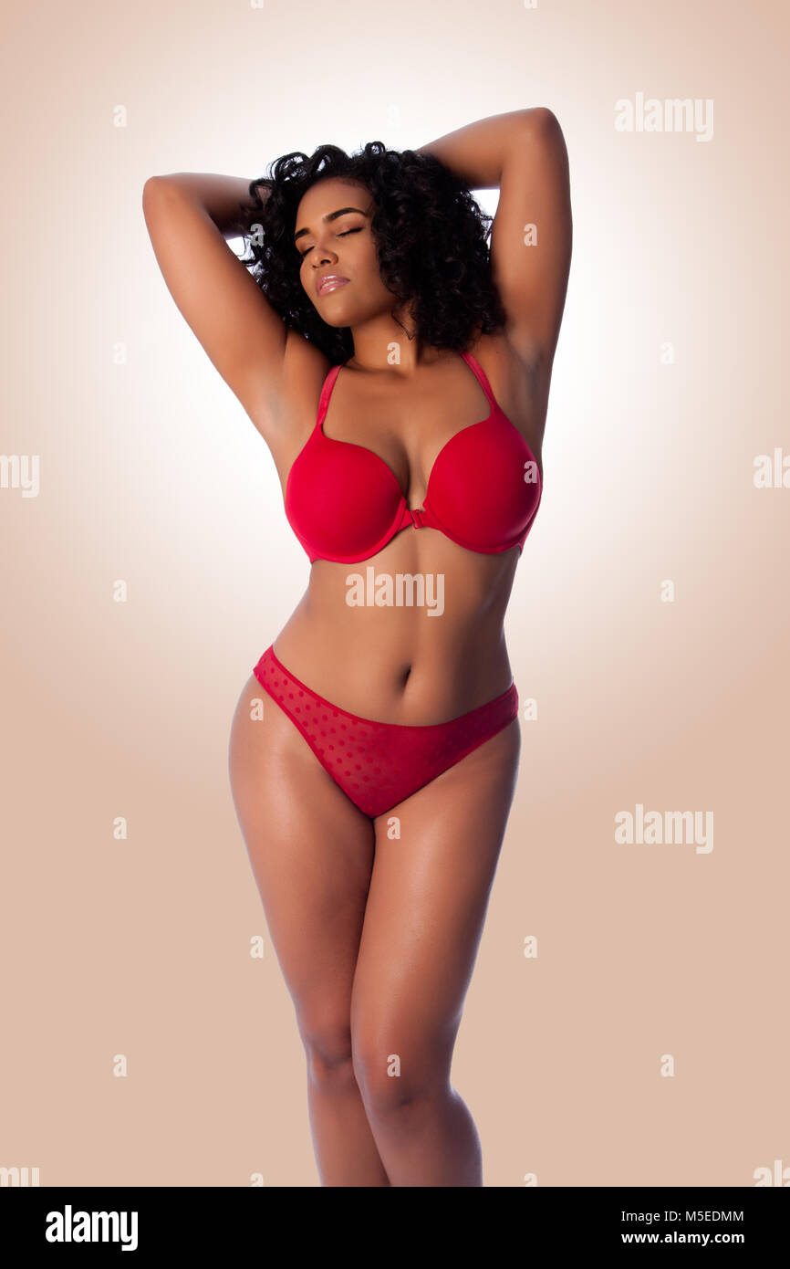 Mature chubby women in lingerie Beautiful Happy Plus Size Sexy Woman With Curly Hair In Red Lingerie Bra And Thong Underwear Stock Photo Alamy