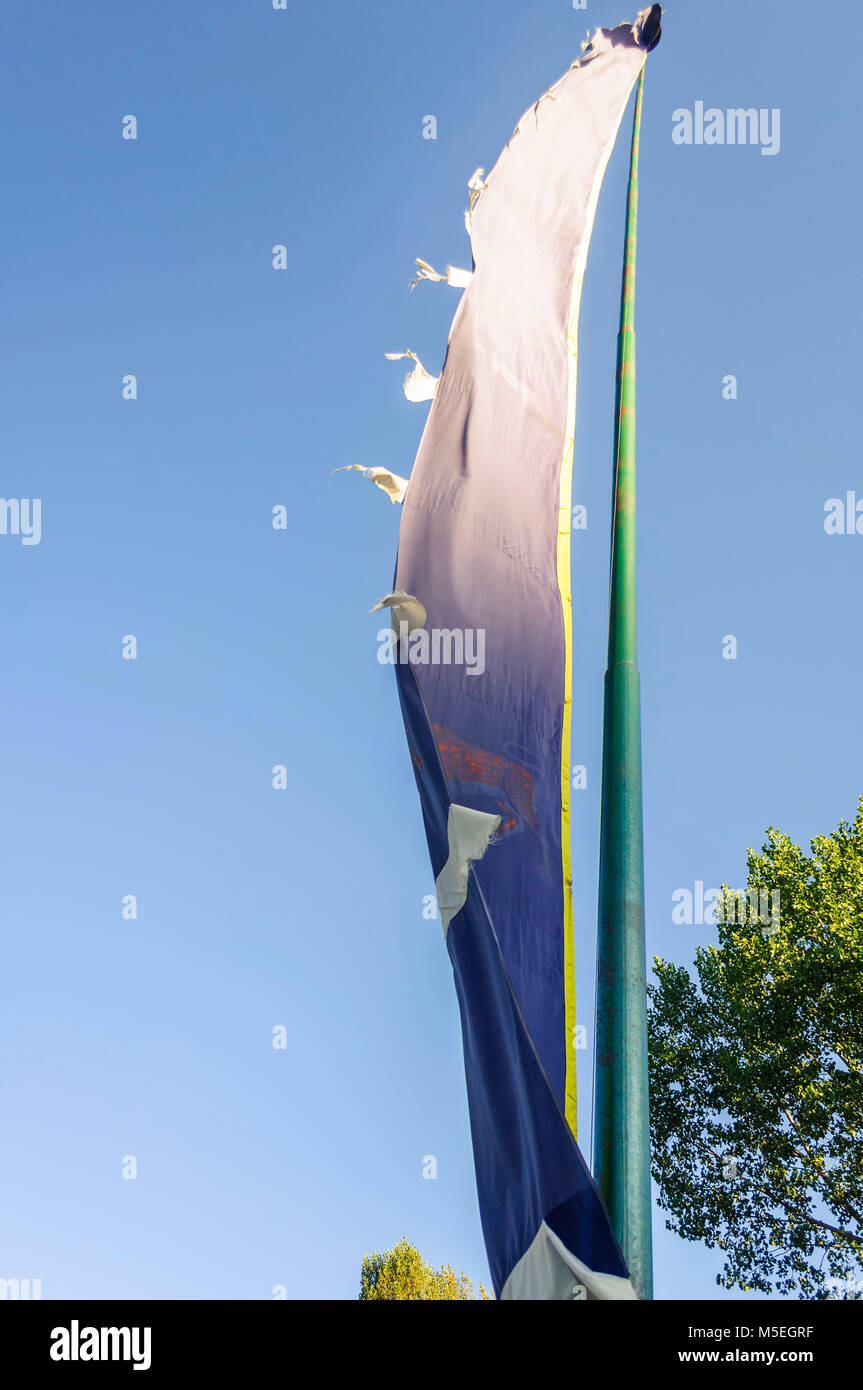 Flags in front Simtokha Dzong, fortress, fluttering in wind, of Thimphu, Thimpu, Bhutan - Stock Image