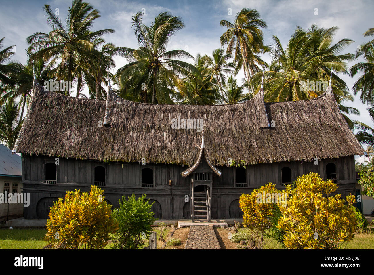 Unique example of Minangkabau Rumah Gadang with thatched roof Minangkabau indigenous type of longhouse. Authentic - Stock Image