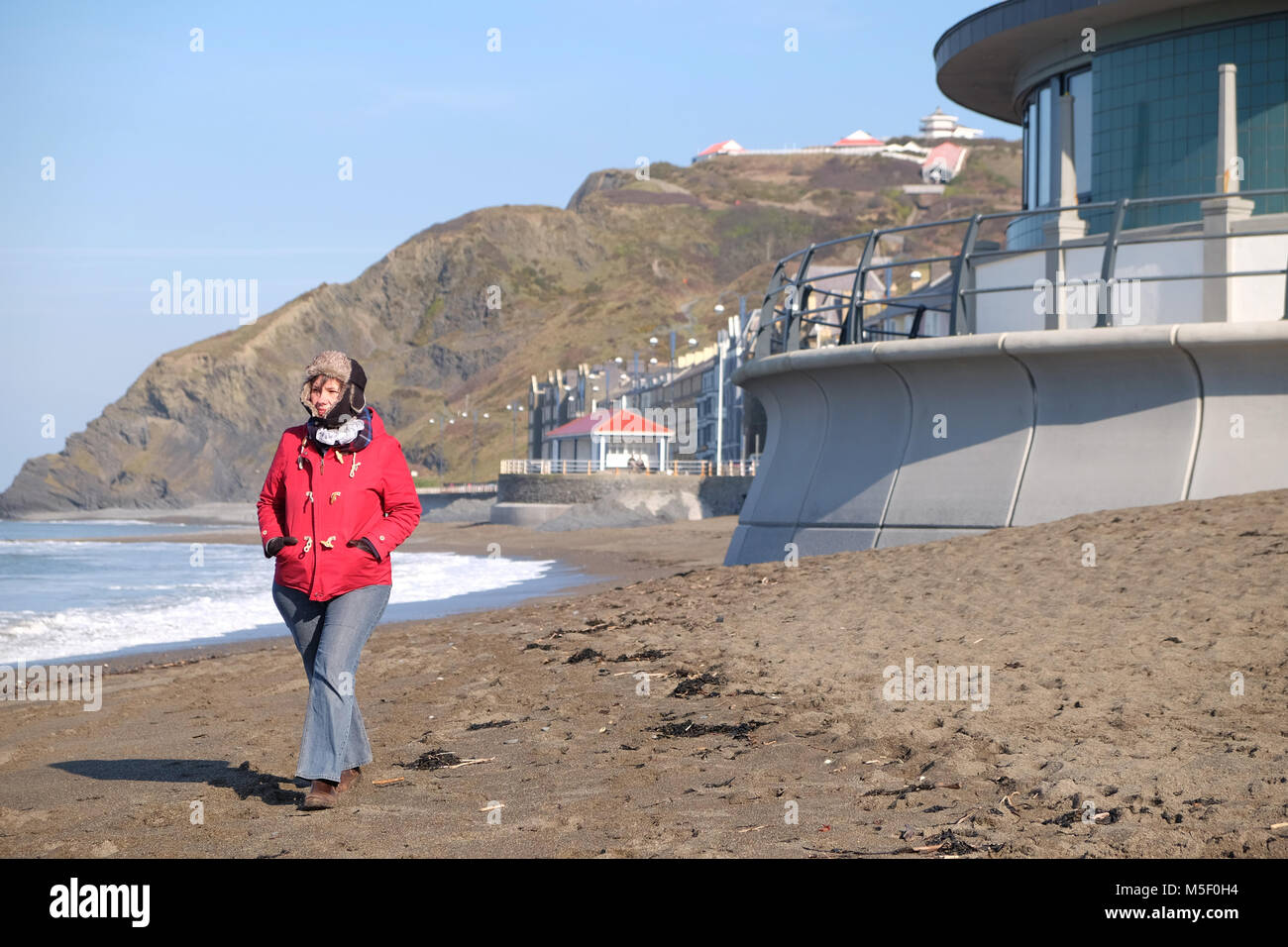 Aberystwyth, Ceredigion, Wales - Friday 23rd February 2018 - UK Weather - Sunny bright weather but cold on the coast - Stock Image
