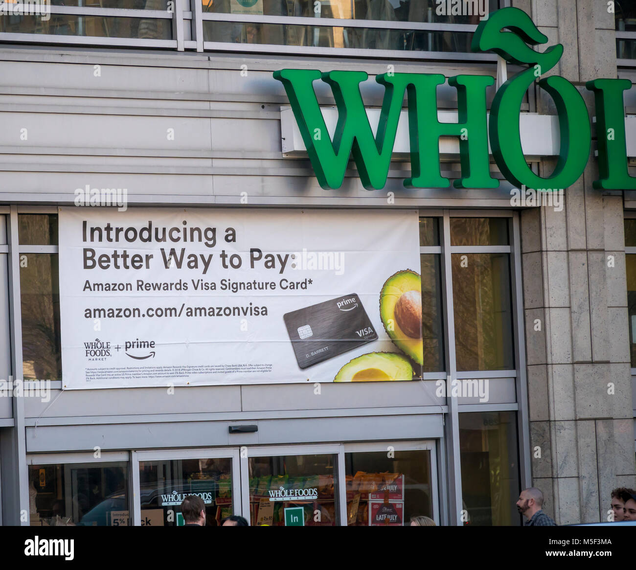 The Whole Foods Market in the Union Square neighborhood of New York advertises  Amazon's offer to Prime members - Stock Image