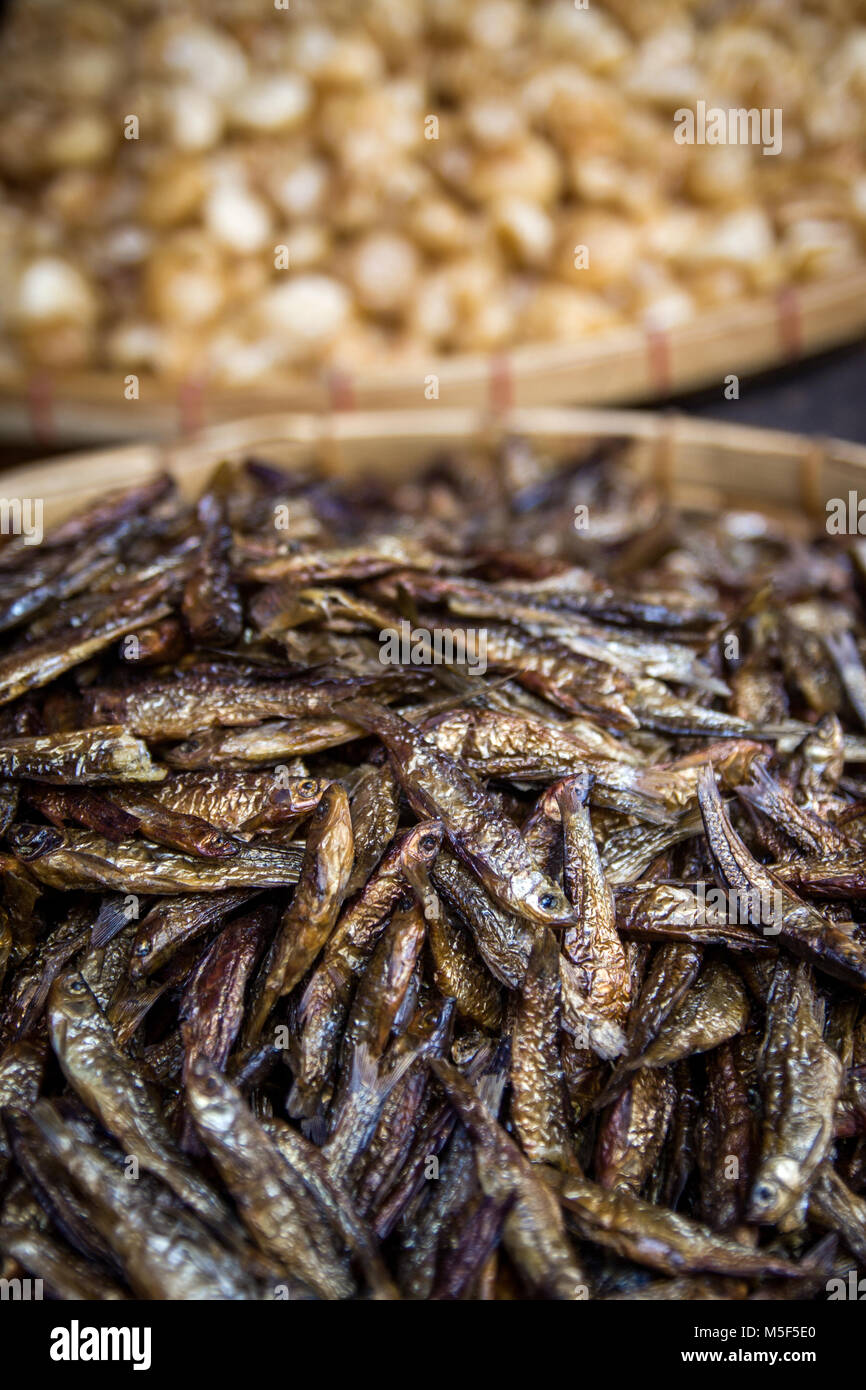 Anchovies dried and for sale on market stall in Indonesia. Anchovies are somewhat like a staple food in Asia. Nutritious - Stock Image