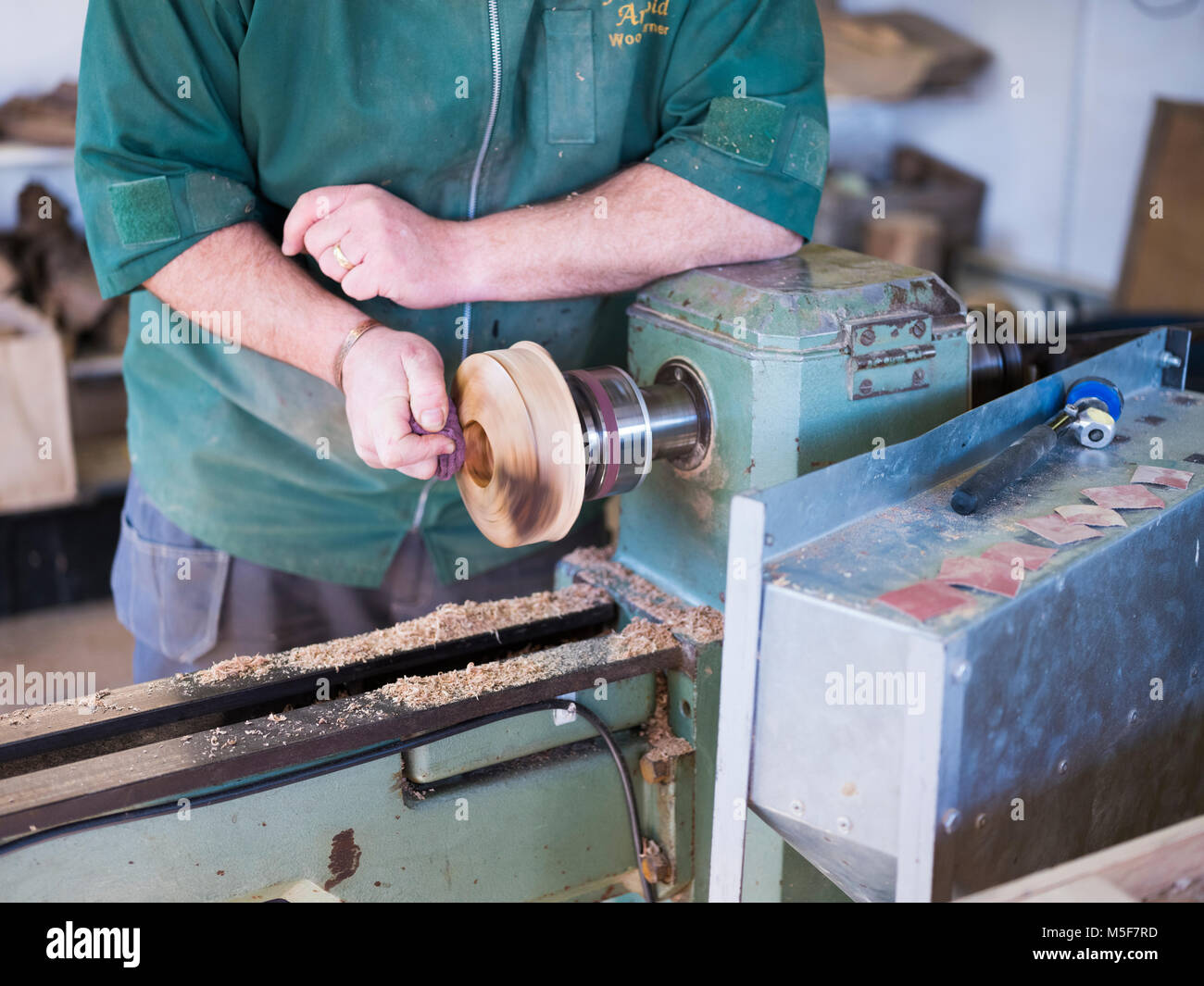 A woodworker, demonstrating spinning. - Stock Image