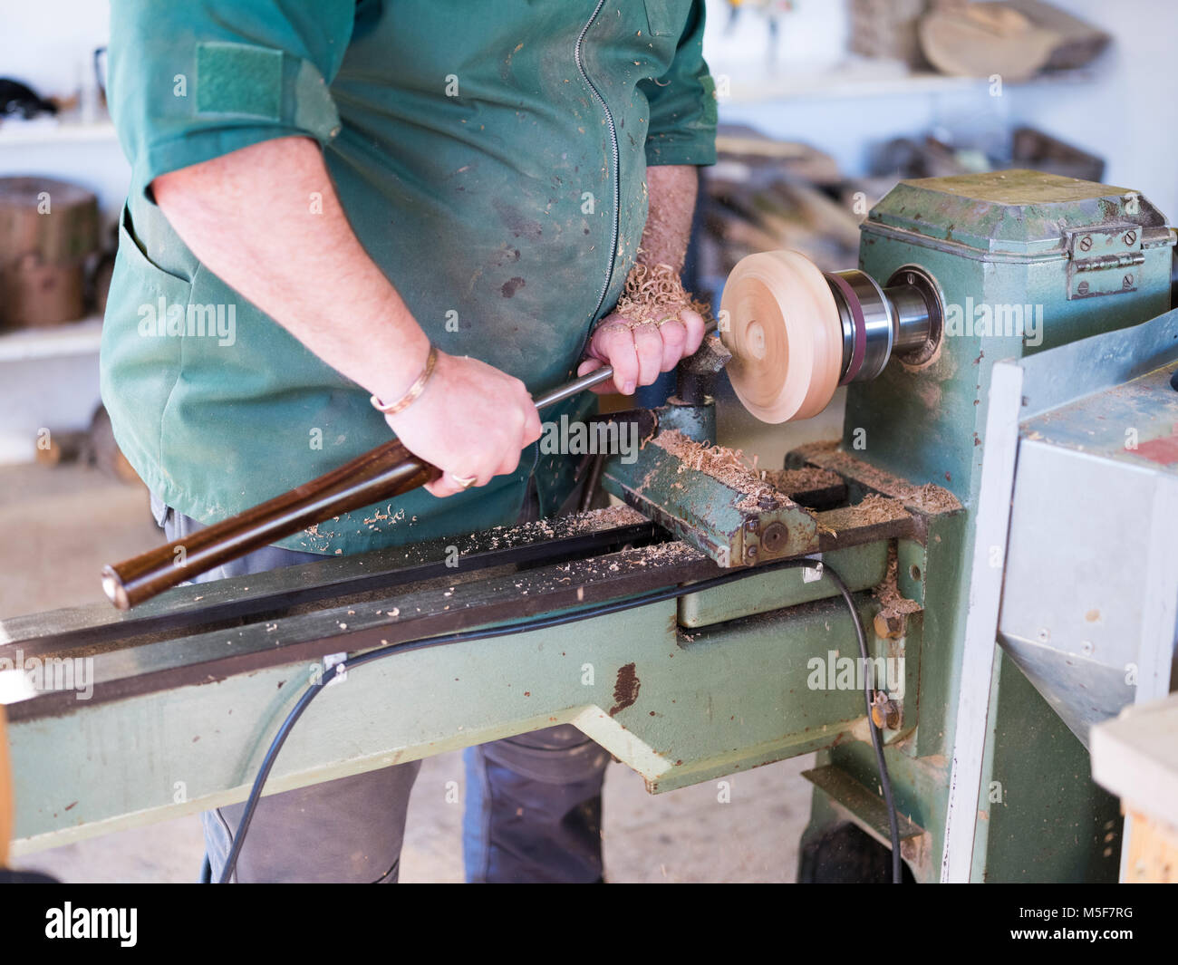 A woodworker, demonstrating spinning. Stock Photo