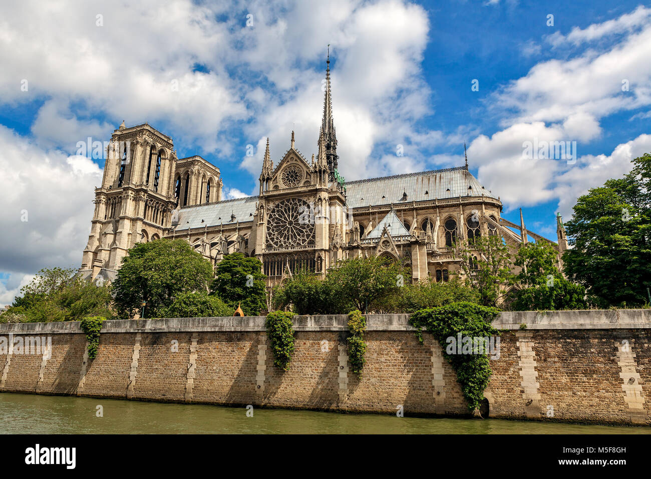 View of famous Notre-Dame de Paris Cathedral under beautiful sky in Paris, France. - Stock Image