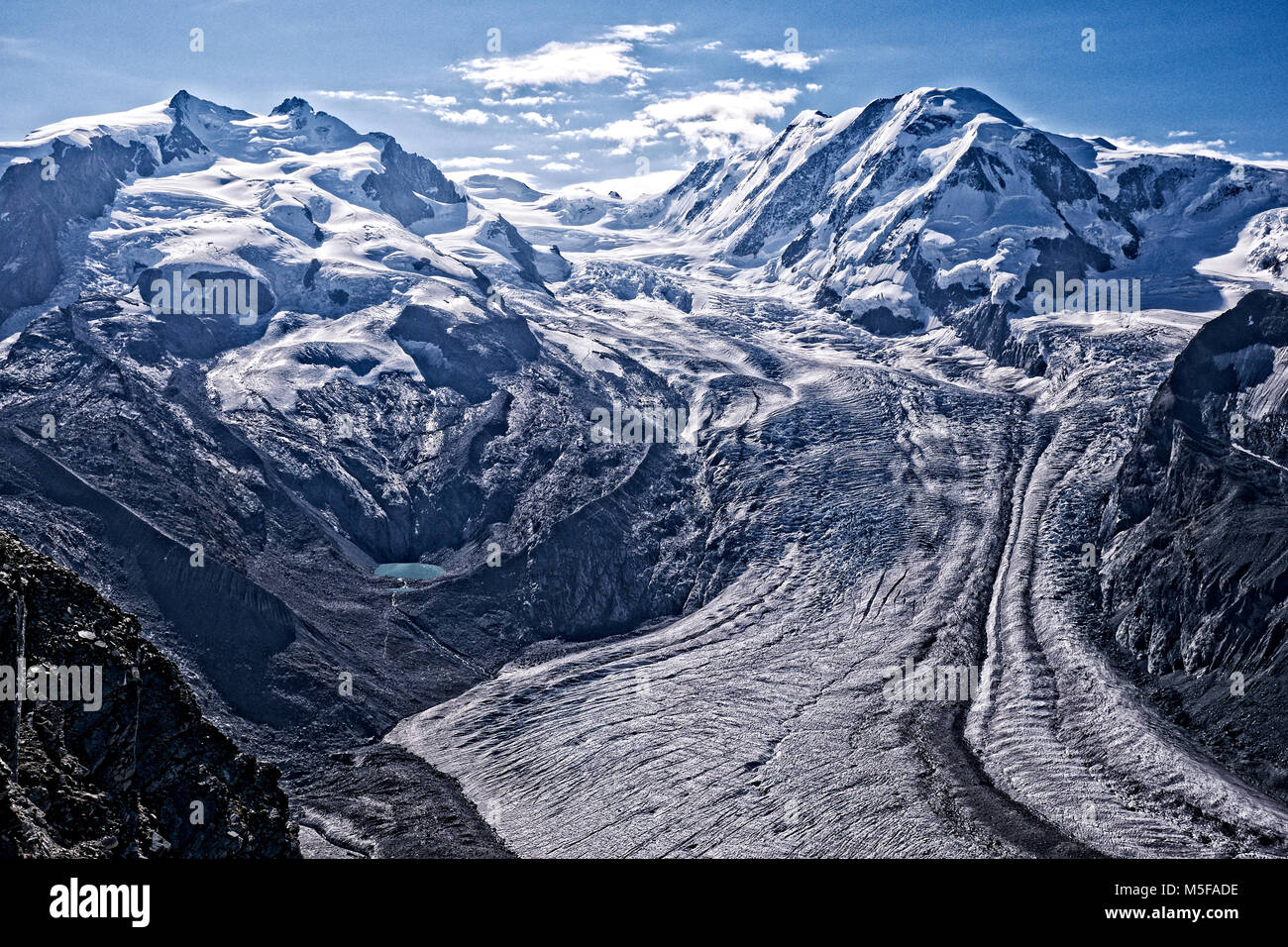 Glacier descending from the Monte Rosa summit above Zermatt, Switzerland. - Stock Image