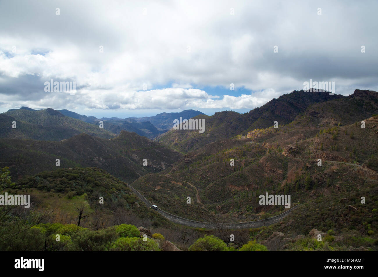 Gran Canaria, february 2018, Las Cumbres - the highest ares of the island, view from under clouds towards sunny - Stock Image