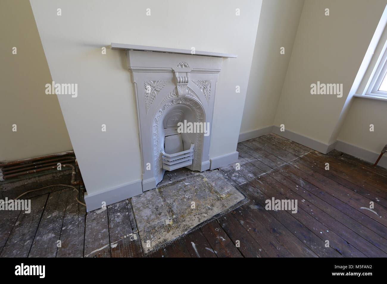 Old bare floorboards in an empty bedroom in a victorian terraced house. Stock Photo