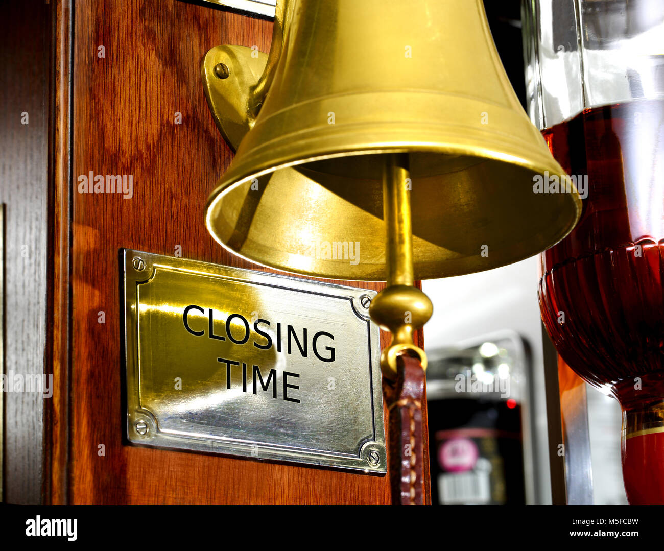 'Closing Time' bell in a British bar - Stock Image