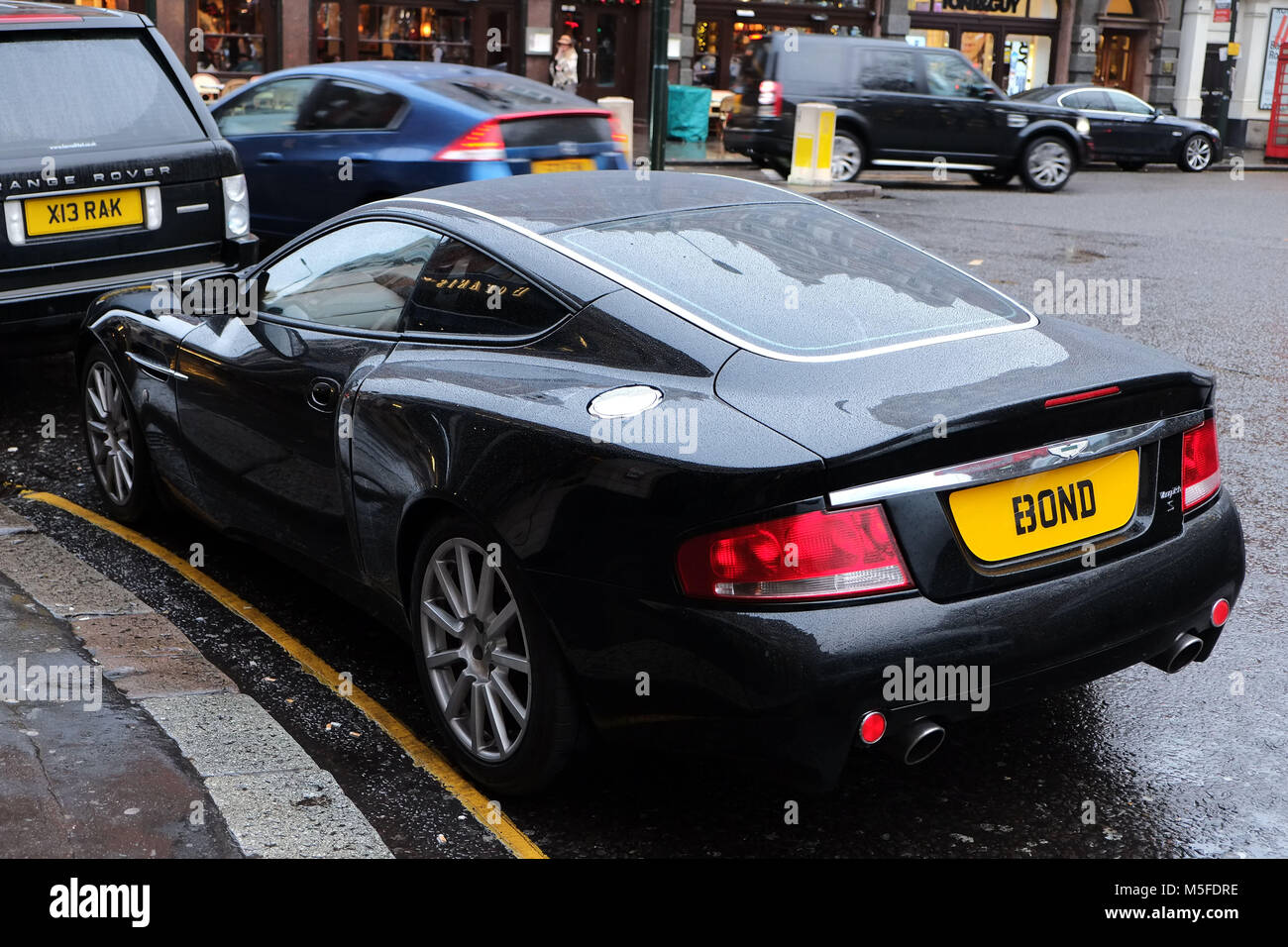 Aston Martin Vanquish parked in Sloane Square London. The owner has modified his E3 ONB number plate to read BOND after the Aston Martin driving Briti & Aston Martin Vanquish parked in Sloane Square London. The owner has ...