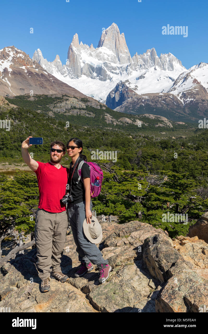 Trekkers take a selfie with Mt. Fitz Roy 3405m; Patagonia; Argentina - Stock Image