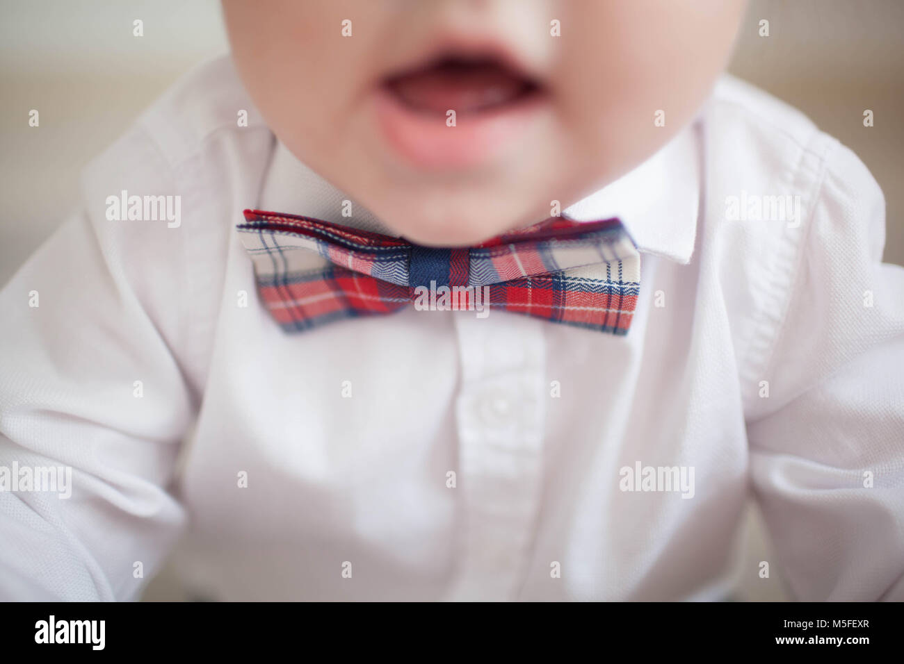Paper bow ties on wooden background. Father's day concept. children's bow tie - Stock Image