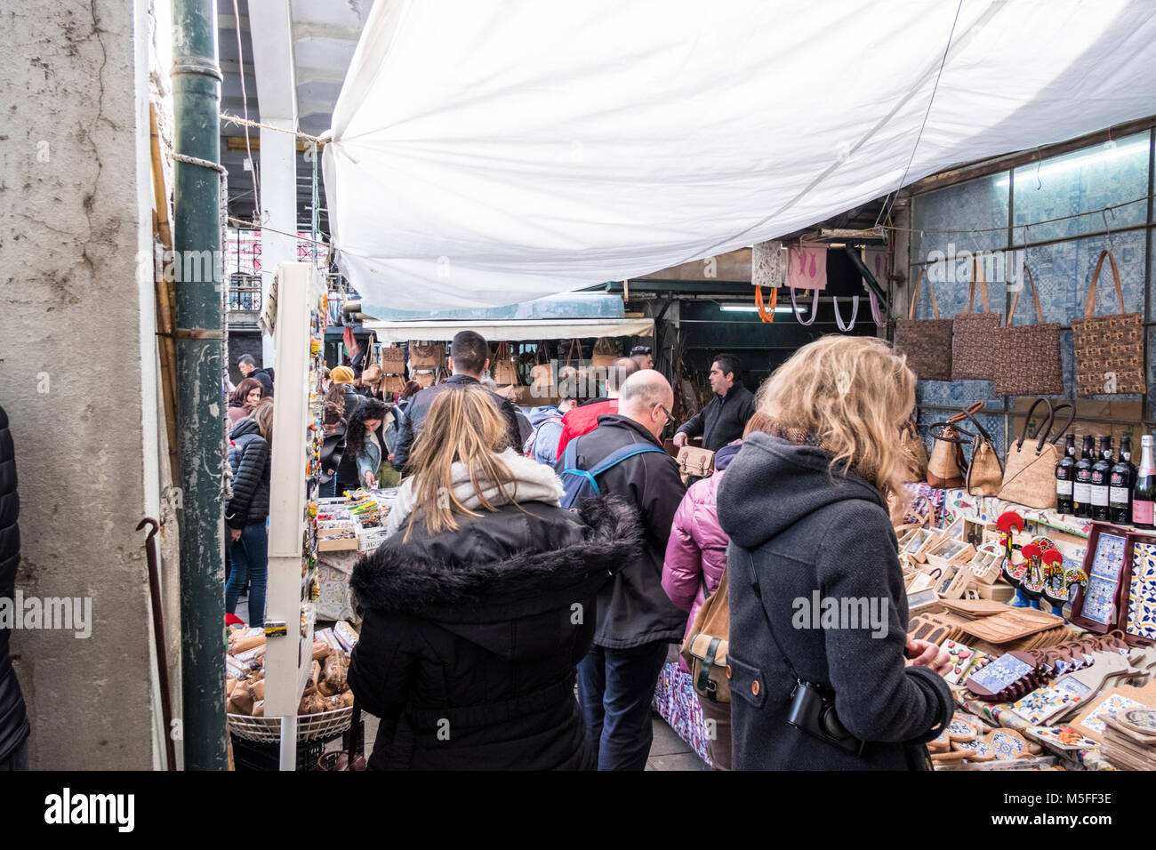 Tourists discovering the market hall in Porto, Portugal - Stock Image