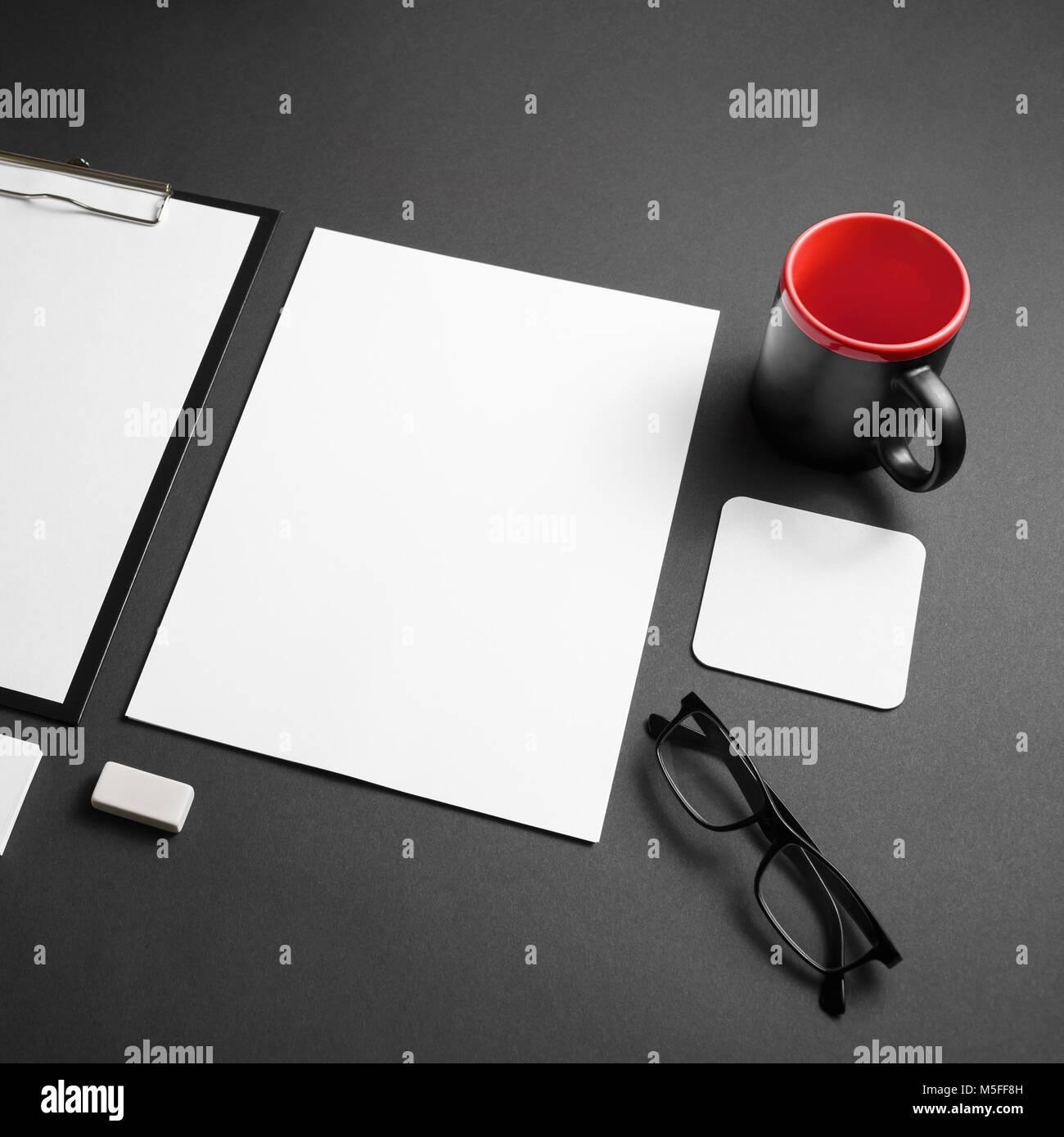 Blank corporate stationery set on black paper background. Branding mock-up. Stock Photo