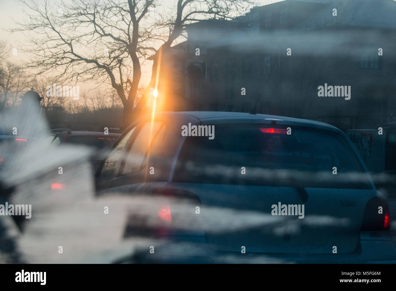 Magdeburg, Germany - 21 February 2018: Symbol for poor visibility in road traffic during the cold season. View from - Stock Image
