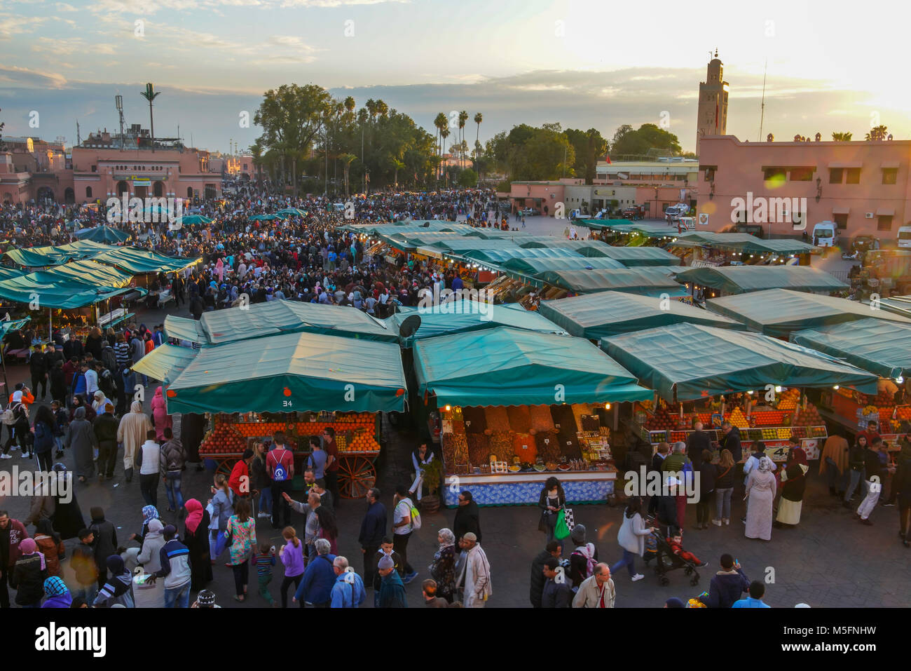 View of the famous Jamaâ El Fna Square and Koutoubia Mosque in Marrakesh, Morocco. - Stock Image