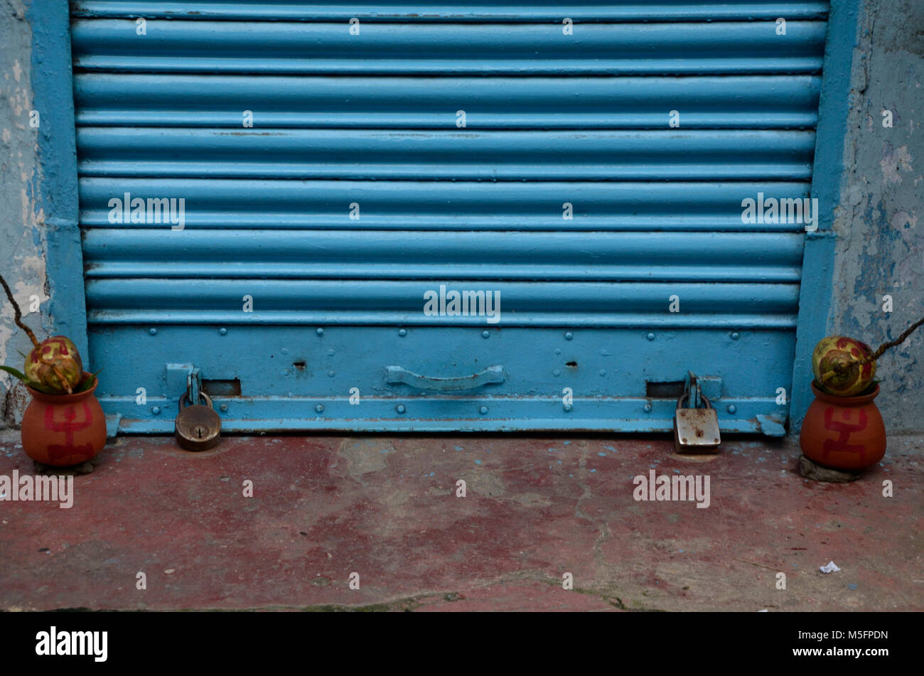 closed shutter with auspicious coconuts, Kolkata, West Bengal, India, Asia - Stock Image