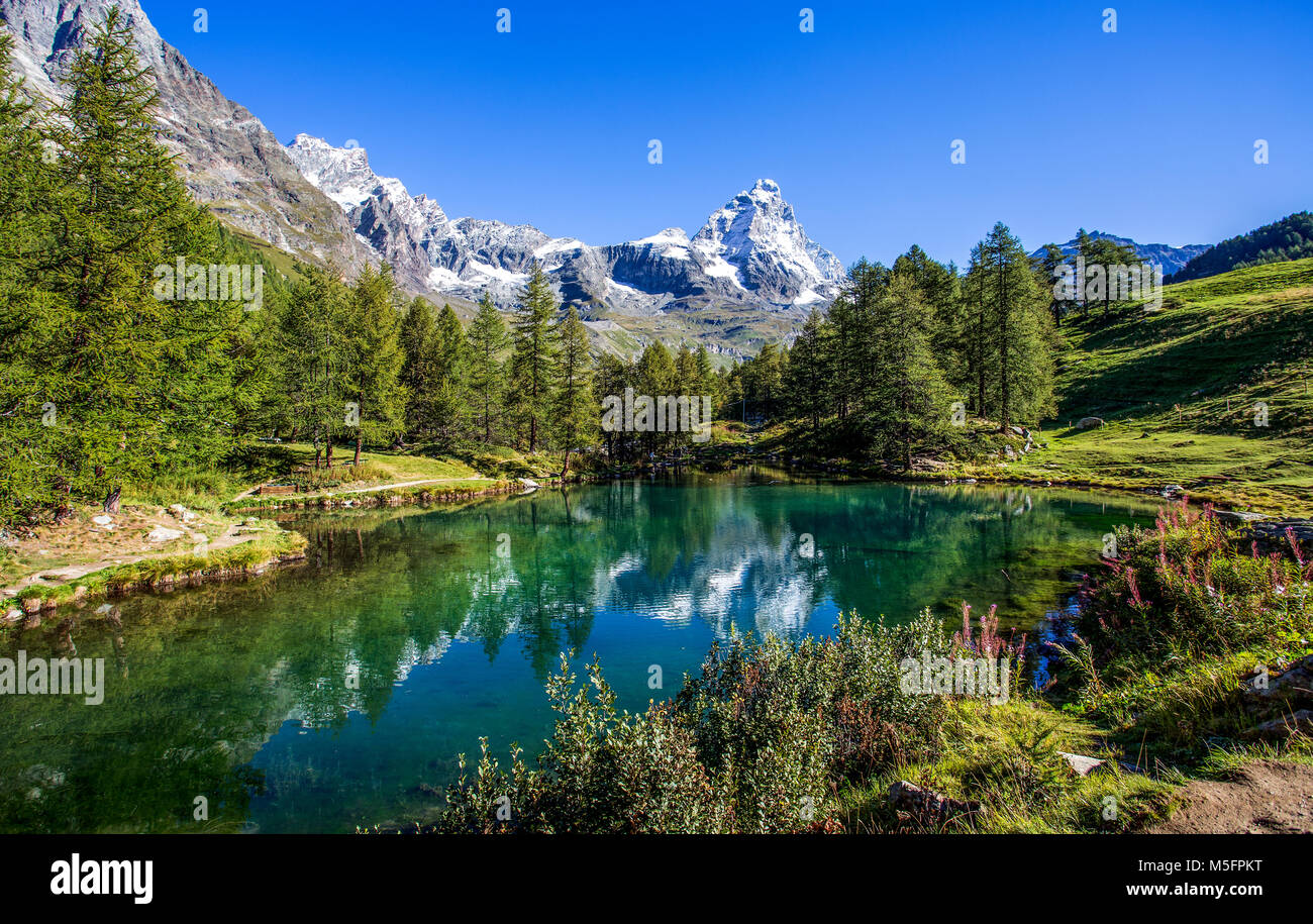 View of the Blue lake (Lago Blu) near Breuil-Cervinia and Cervino Mount (Matterhorn) in Val D'Aosta,Italy - Stock Image