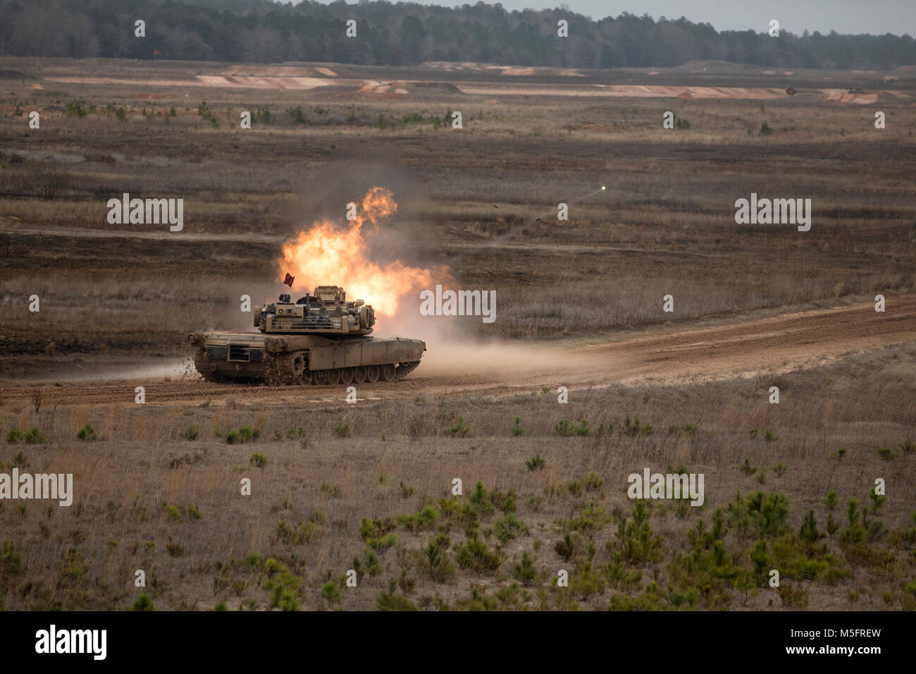 An M1A1 Abrams tank with 2nd Tank Battalion, 2nd Marine Division engages a target during semi-annual qualifications Stock Photo