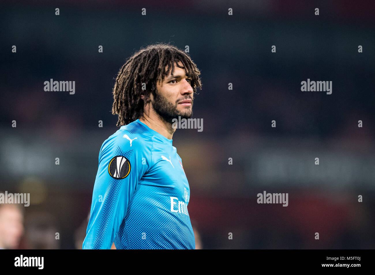 LONDON, ENGLAND - FEBRUARY 22: Mohamed Elneny (35) of Arsenal during UEFA Europa League Round of 32 match between Stock Photo