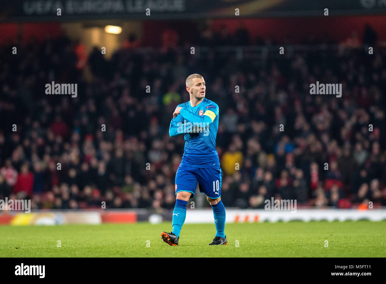 LONDON, ENGLAND - FEBRUARY 22: Jack Wilshere (10) of Arsenal during UEFA Europa League Round of 32 match between - Stock Image