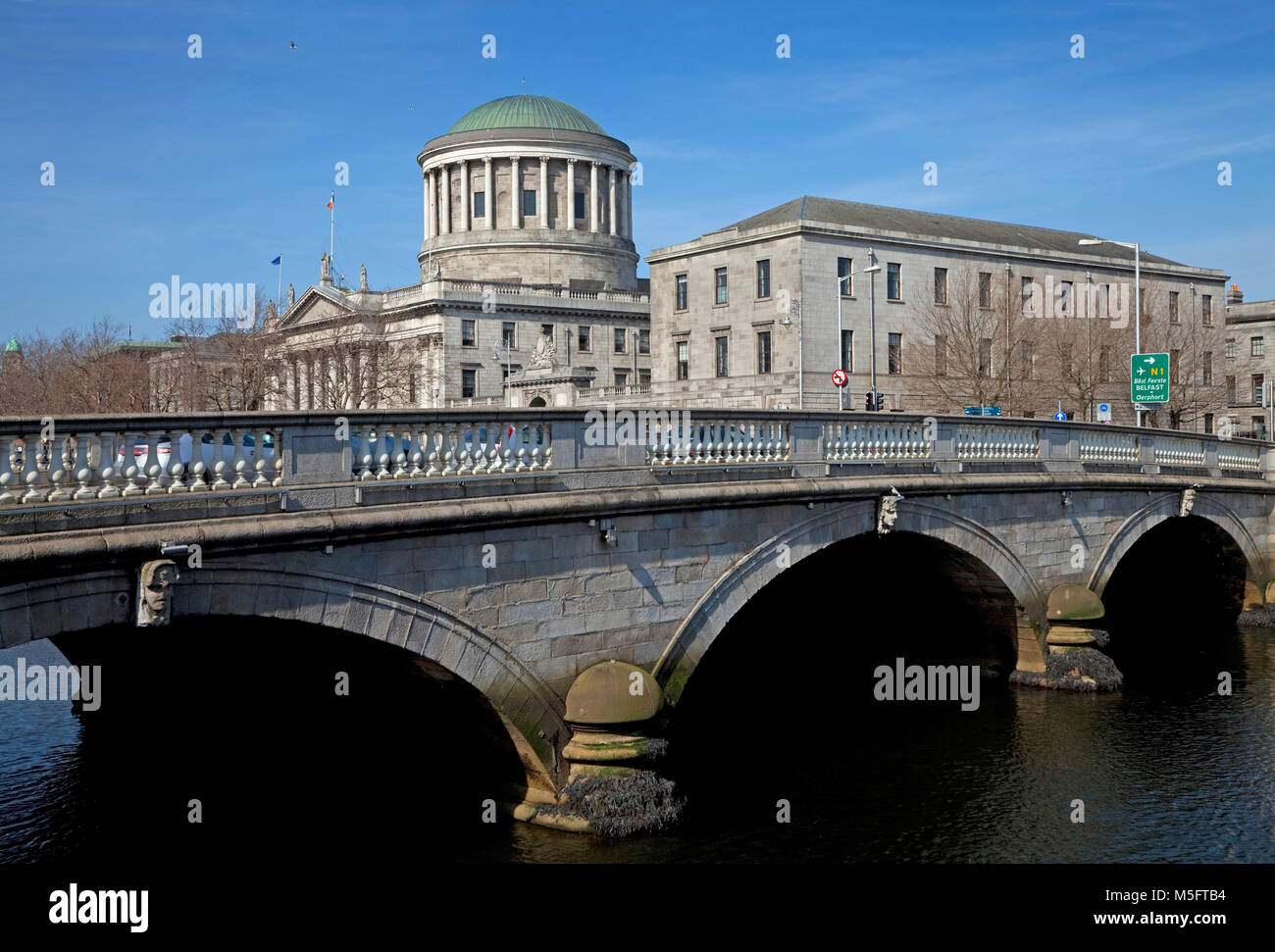 O'Donovan Rossa Bridge and the Four Courts designed by James Gandon in 1786 and  restored after Irish Civil - Stock Image