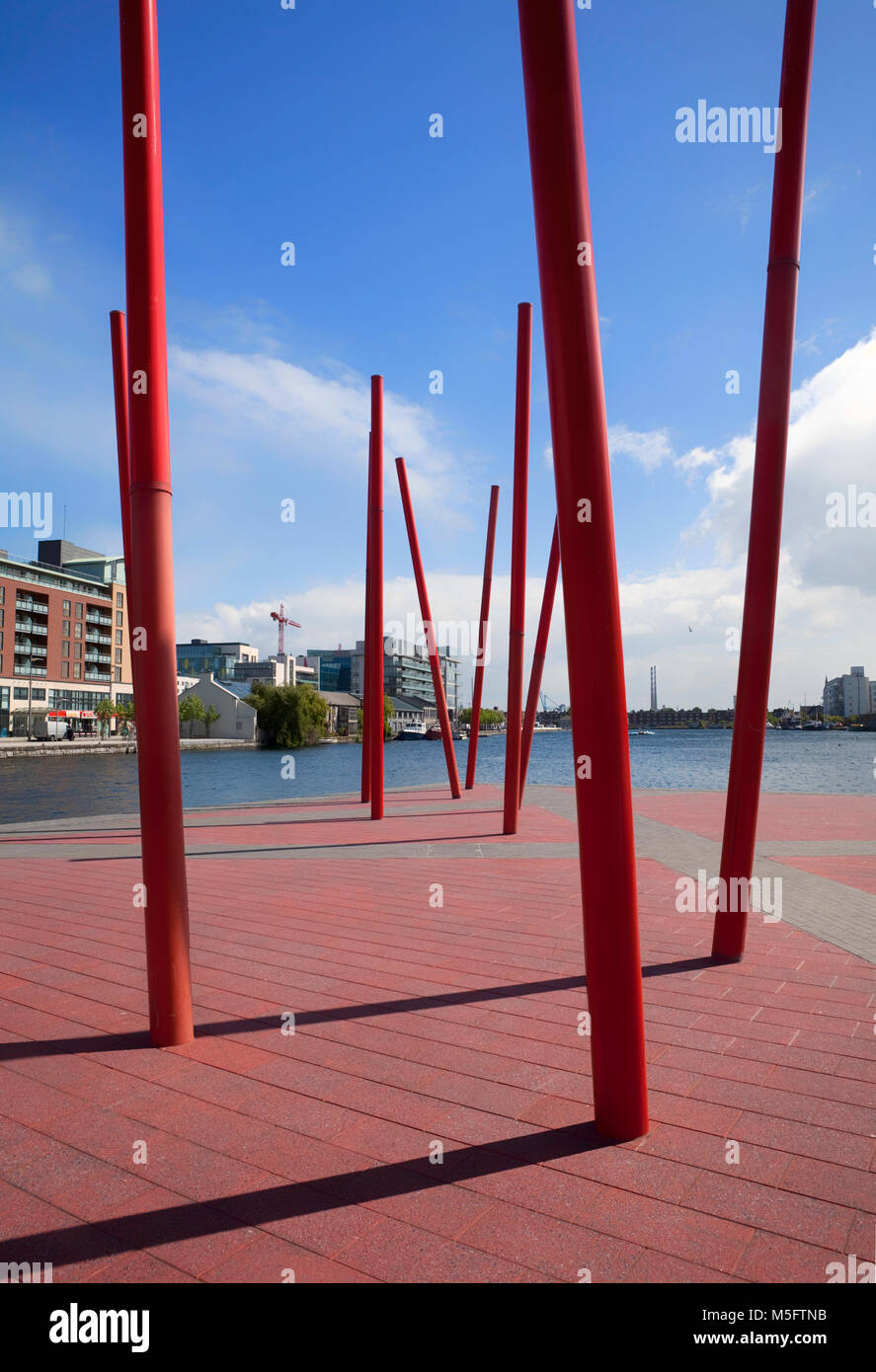 Pole scupture on the Grand Canal Basin, part of the Dublin Docklands area redevelopment project of many high-tech - Stock Image
