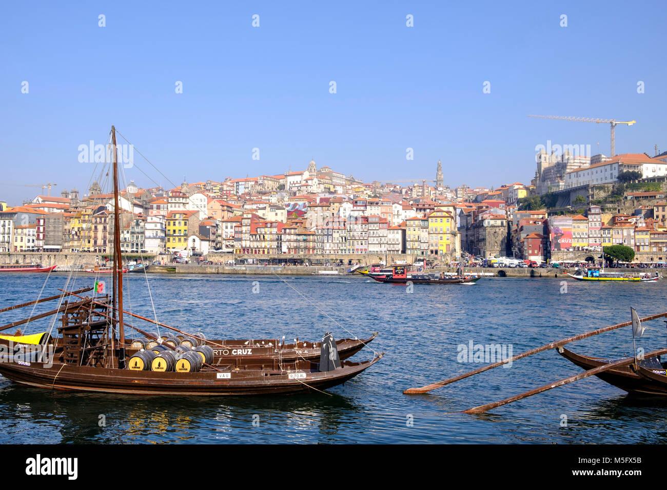 Douro River waterfront in Gaia with Barrio La Ribeira across river and Rabelo Boats, Porto, Porto Region, Portugal - Stock Image