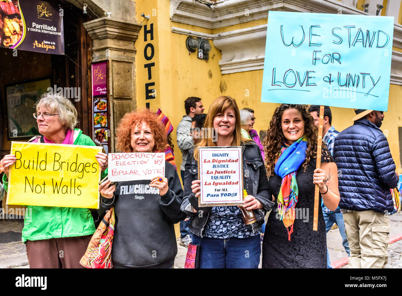 Antigua, Guatemala - January 21, 2017: Women hold signs in peaceful Women's March as part of global protest - Stock Image