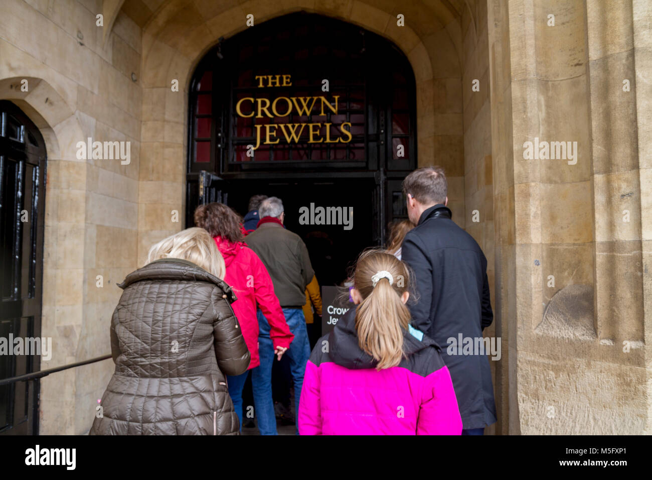Tourists visiting the Crown Jewels at The Tower of London, Tower Hill London UK Stock Photo