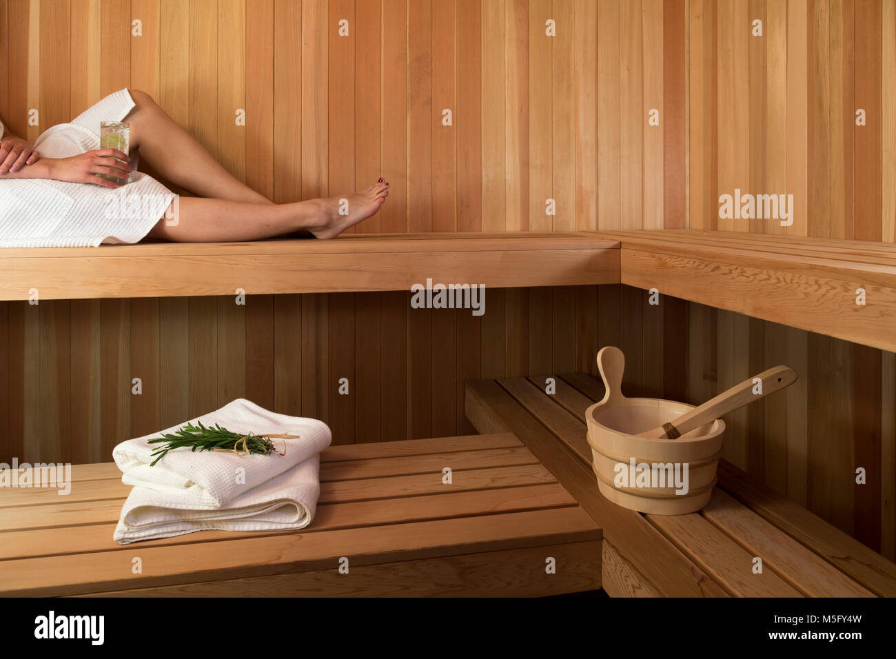 Woman is Sauna with beverage and herbs, Blair Hill Inn, Greenville, Maine - Stock Image