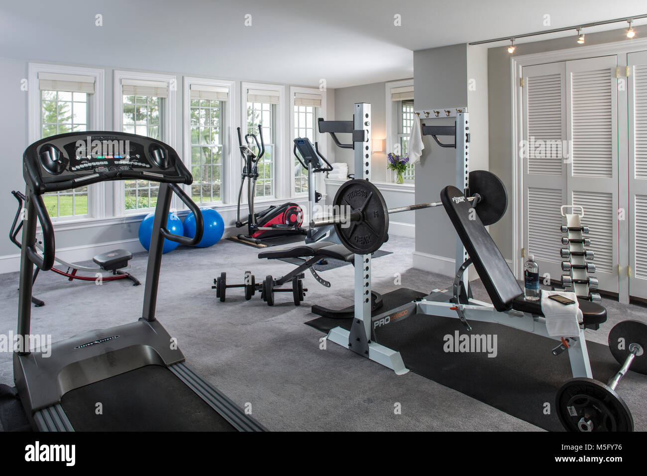 Gym with treadmills weights and machines, Blair Hill Inn, Greenville, Maine - Stock Image