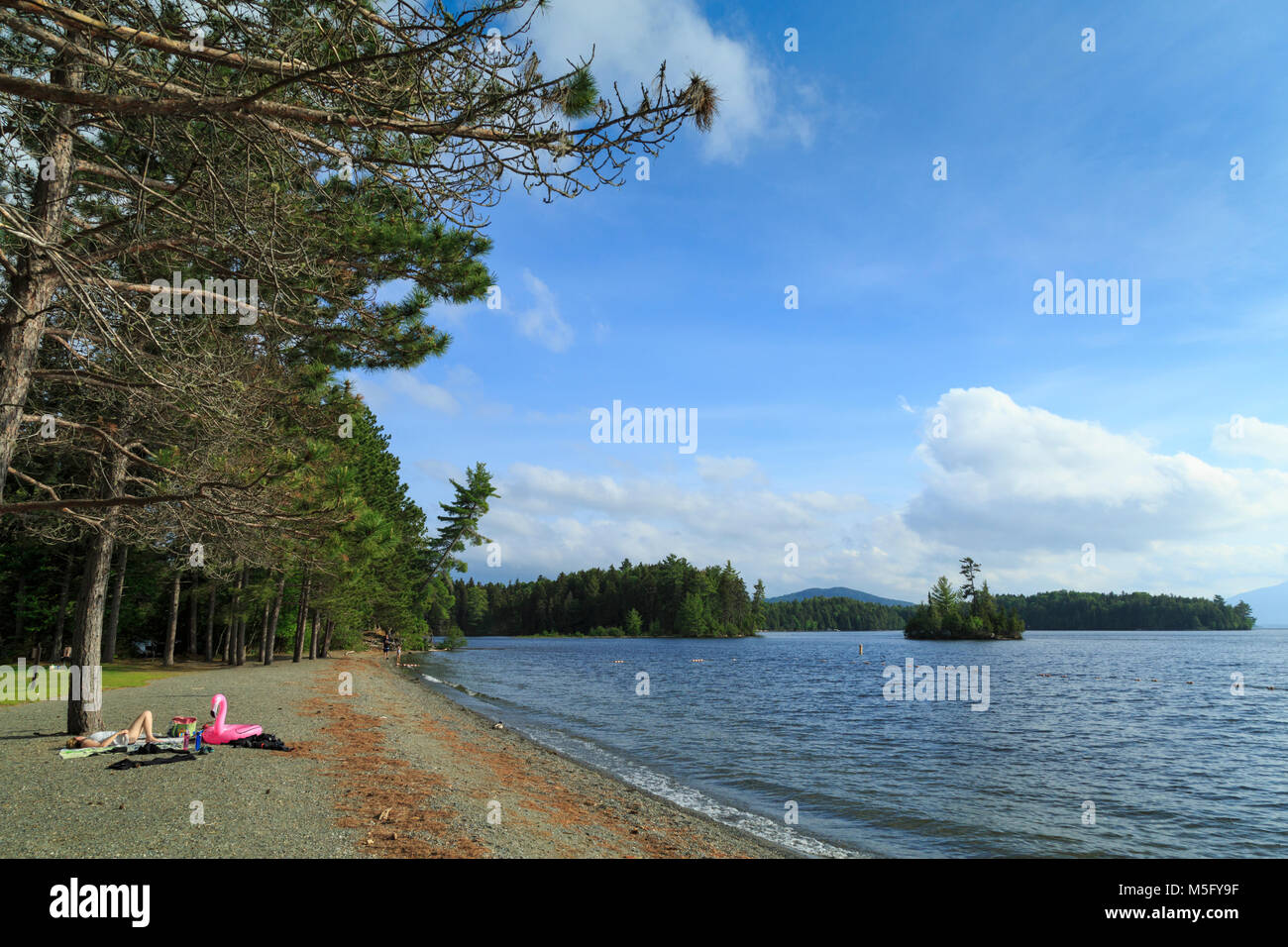 Lone Sunbather by Lake Lily Bay State Park, on Moosehead Lake Stock on