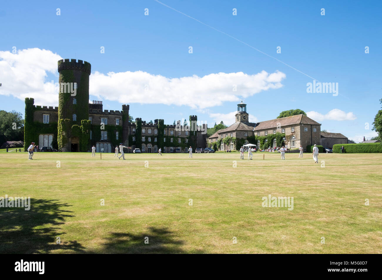 Cricket match in front of Swinton Park in Yorkshire - Stock Image