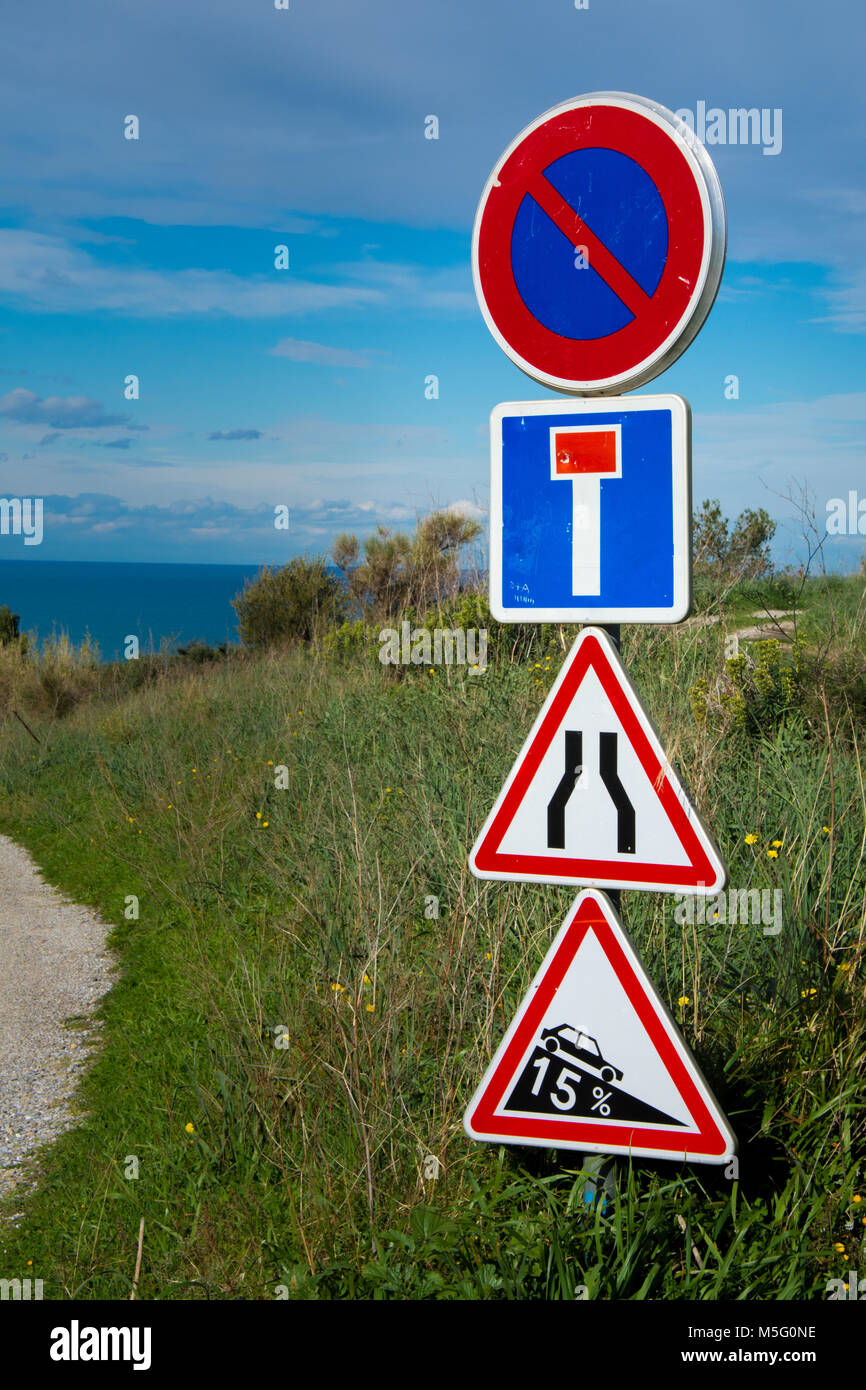 Vertical view of French road signs on a countryside dirt road - Stock Image