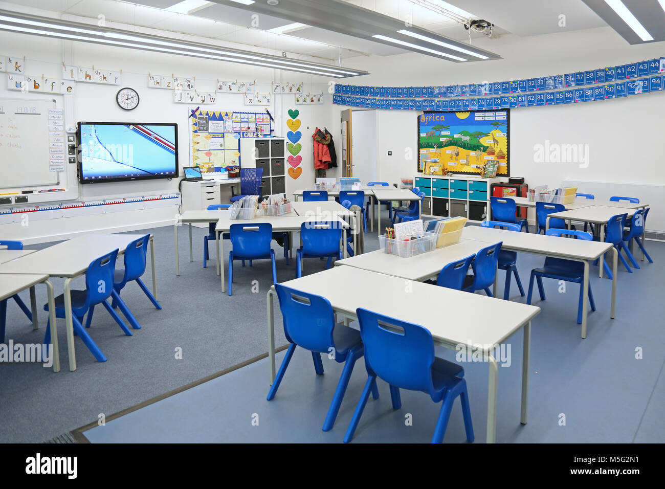 Charmant Classroom In A Newly Built London Primary School. Shows Desks Arranged Into  Groups.