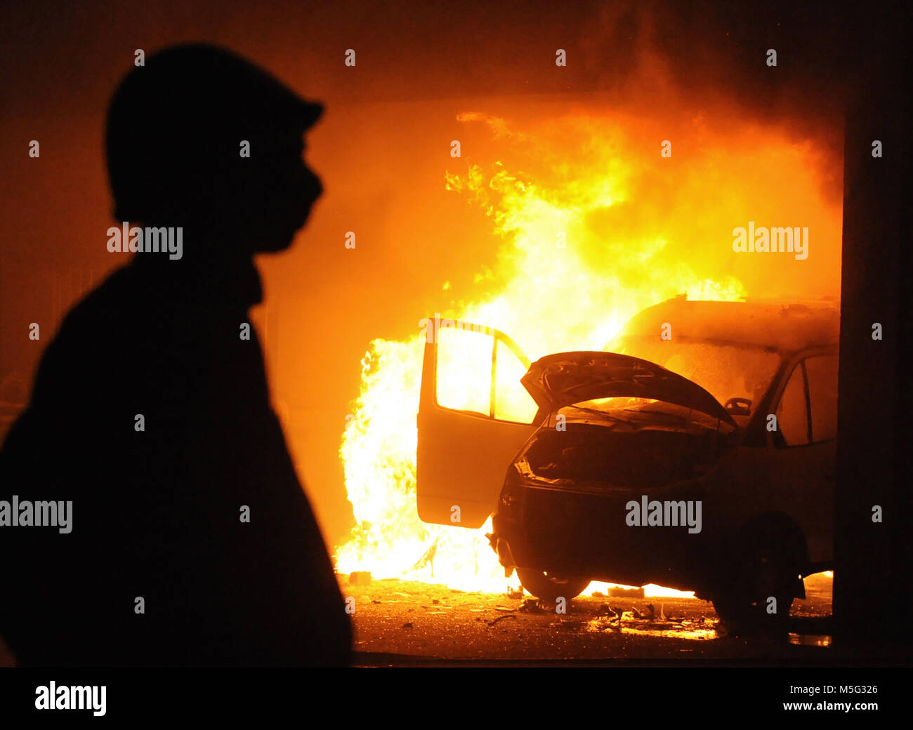 burning car, unrest, anti-government, crime - Stock Image
